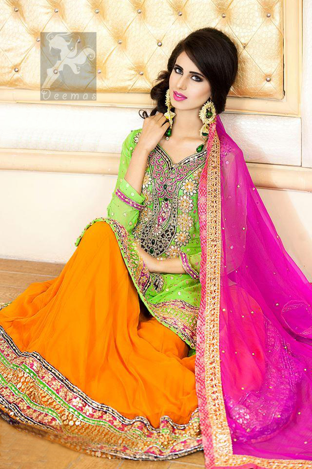 Pakistani Mehndi Dress having Bright Green Shirt With Orange Lehenga and Shocking Pink Dupatta