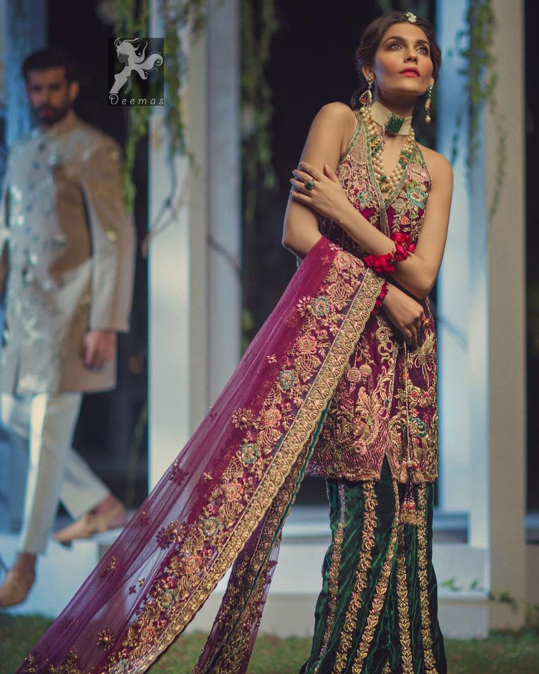 Claret colour peplum having halter neck design with bottle green loose trousers and heavy embellished Dupatta