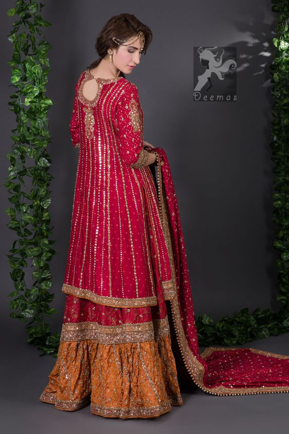 Crimson A-line slits shirt adorned with beautiful neckline, stripes and hemline. Matching dupatta having embellished border on four sides, sequins and small motifs spray all over it. Lehenga in Crimson and Copper having embellished Gott like gharara (below the knee), stripes and small motifs spray. Embellishment in light and dark antique shades.