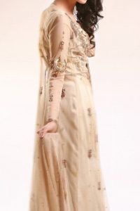 Fawn Blouse adorned with antique gold and brown embellishment. Fawn pure crinkle chiffon gown center slits border has been adorned with light embellishment border and follows small motifs and sequence spray all over it. Pure crinkle chiffon sharara and dupatta has sequence spray all over it.