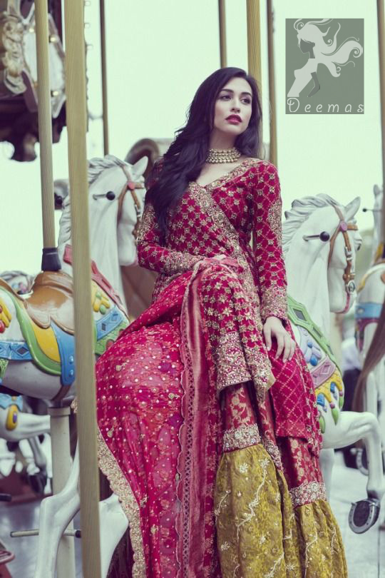 Cardinal pink self embroidered chiffon angrakha style gown. Gown adorned with dull golden and antique shades of embellishment. Pure banarsi chiffon jamawar dupatta having embellished border and small motifs spray. Pure banarsi chiffon jamawar gharara in Cardinal Pink and Mehndi Green.