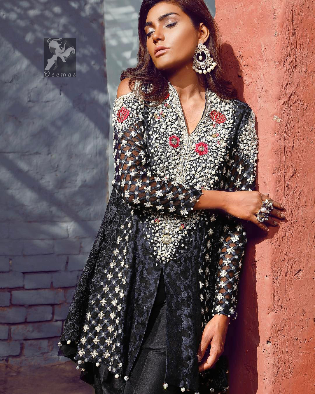 Black peplum made with pure banarsi jamawar chiffon. Peplum having multiple panels of different banarsi patterns. White and silver embellishment on neckline, side panels and sleeves. Pure raw silk sharara pants.