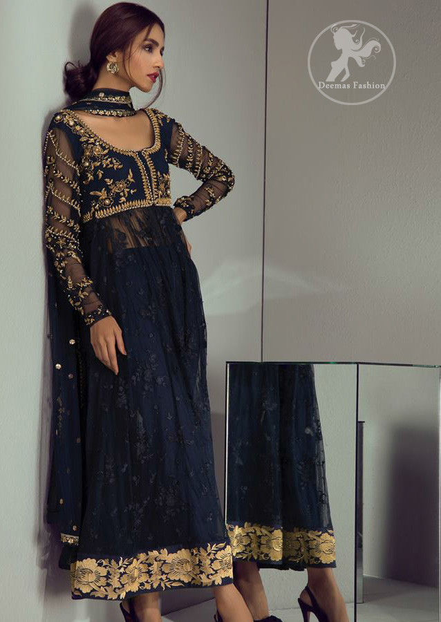 Look alluring in this floor length frock embellished with golden kora dabka, intricate embroidered motifs and detailed bodice. The border on the daman is enhanced with thread embellished floral pattern detailing that instantly draws attention. It comes with matching cigarette pants. It is paired up with dark blue dupatta with sequins sprinkled and finished with light embroidered edges.
