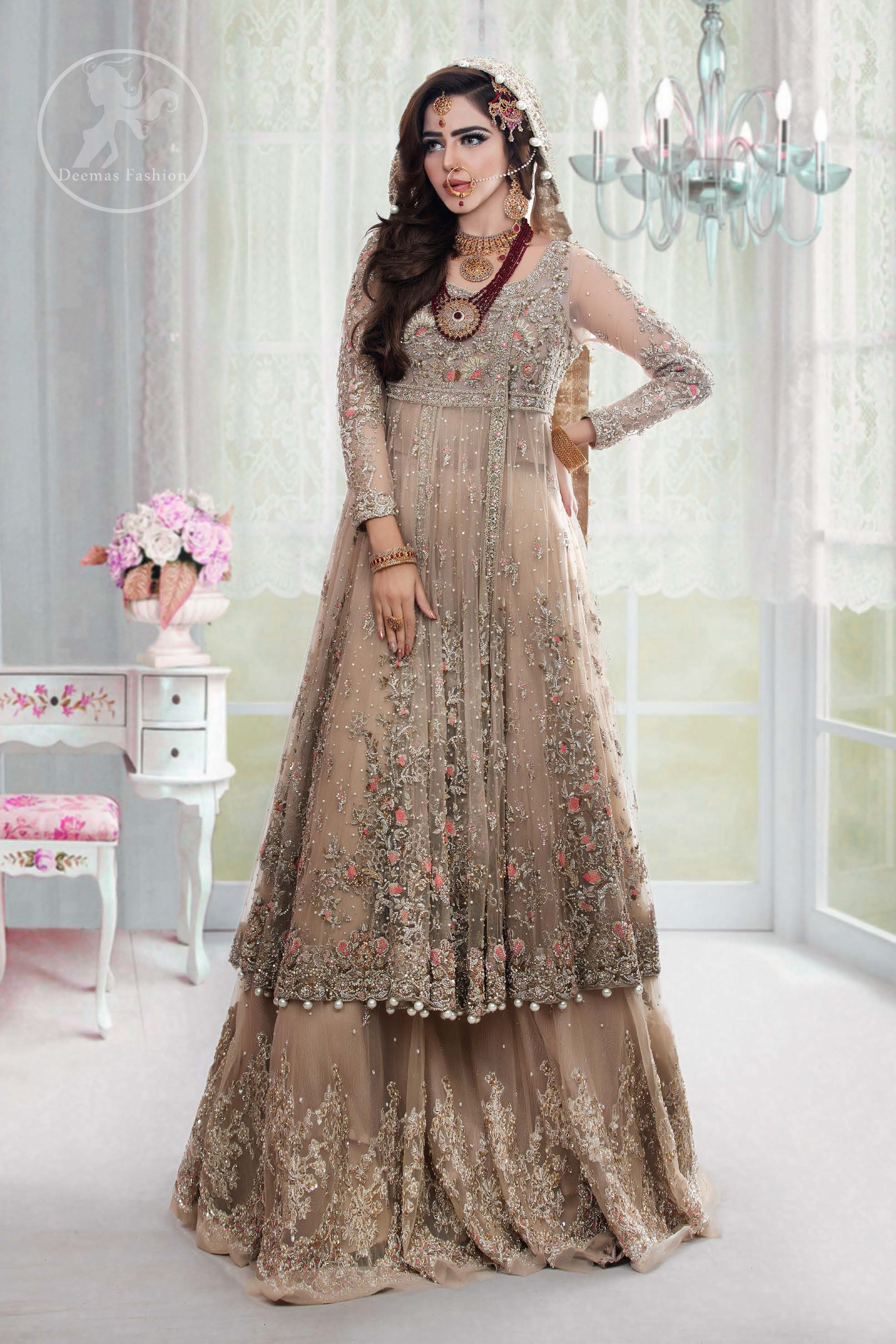 This outfit is meticulously featuring antique shades of kora, dabka, tilla, sequins and pearls.