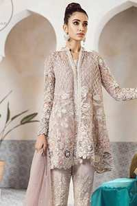 This beautiful peplum is adorned with floral embroidery. It is meticulously highlighted with silver kora, dabka, tilla, sequins, and pearls. It is further enhanced with scalloped border which adds to the look. Sleeves are fully embellished. It is artistically coordinated with embroidered pajama. It comes with chiffon dupatta which is sprinkled with sequins all over it.