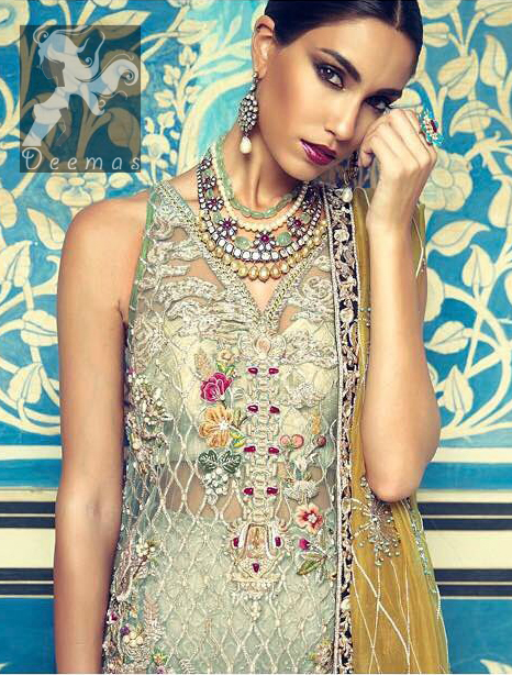 This shirt is decorated with resham threads, kora, dabka, tilla, sequins and pearls. The shirt is beautifully decorated with self embroidered criss cross pattern. It is further enhanced with embroidered scalloped border which adds to the look. It comes with brocade bell shaped trousers. It is beautifully coordinated with organza mehndi colored dupatta, allured with four sided embellished appliqued border.