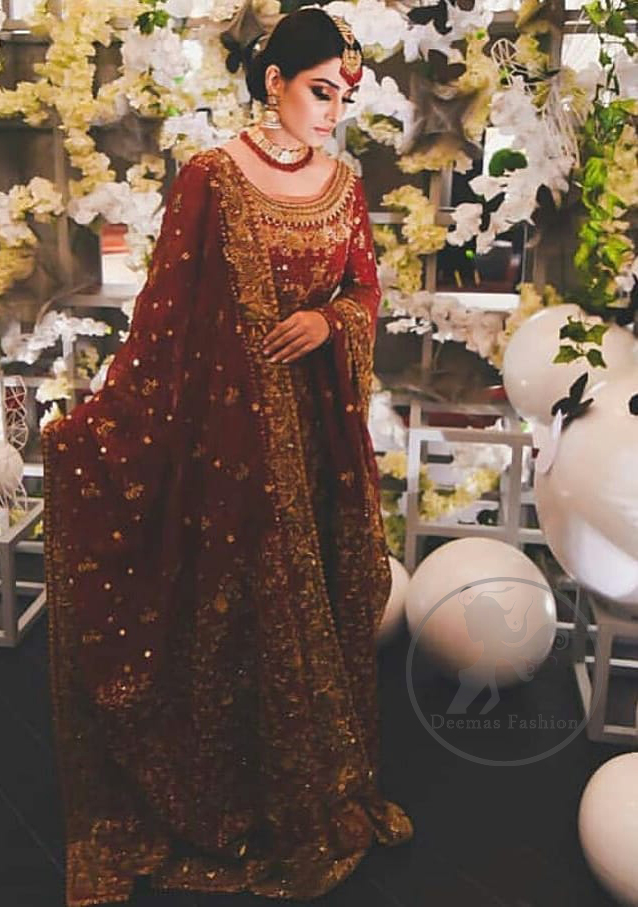 This dress is beautifully sculptured with floral embroidery. It is allured with red, dull golden, champagne and antique shaded kora dabka, tilla, sequins and pearls. It is adorned with beautiful U-shaped embellished neckline which adds to the look.It is artistically coordinated with rust embellished lehenga. It comes with burnt red dupatta which has heavy work on pallu and four sided embroidered border. Dupatta is sprinkled with small sized floral motifs all over.