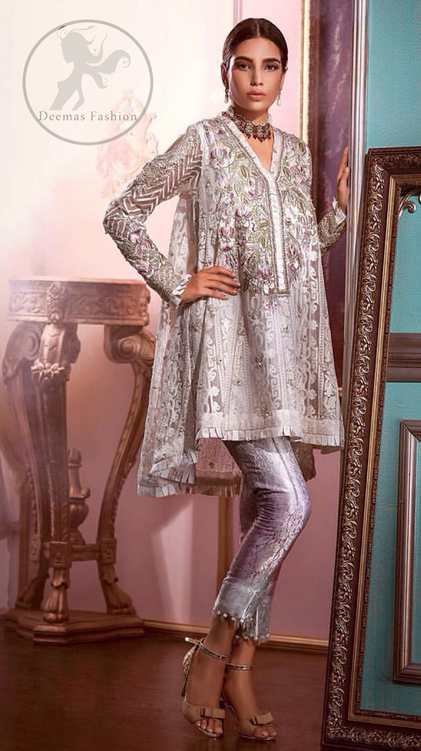 Reflecting exuberant color play in this ethereal piece meticulously highlighted with Swarovski, pearl and silver gold kora dabka. The neckline is fully embellished with multiple color thread embroidery and floral motifs. Cold shoulder sleeves also decorated with silver gold kora dabka , tilla and thread embroidery. It comes with matching chiffon dupatta and pajama.