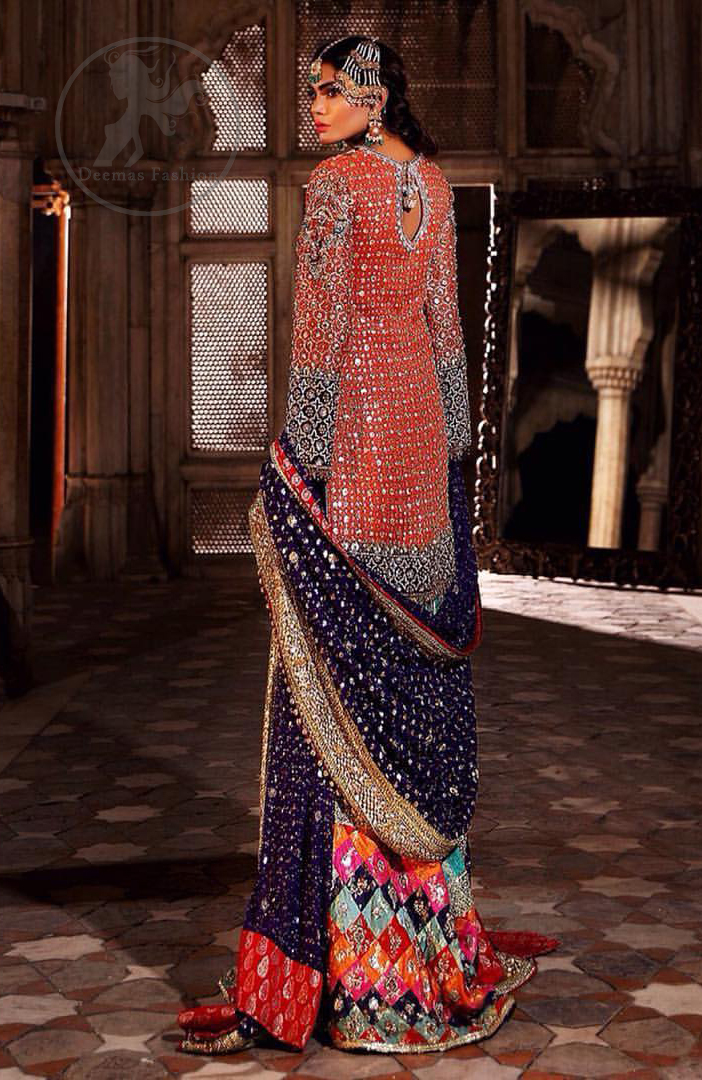 This unique bridal dress is beautifully sculptured with floral thread embroidery. It is meticulously highlighted with silver and antique kora dabka, tilla, sequins and pearls. It is artistically paired up with brocade gharara which is embellished with different color applique. It comes with chiffon dupatta which has four sided embellished border and sprinkled with sequins all over it.
