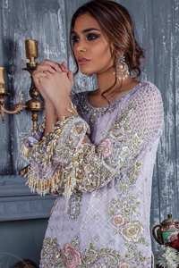 Standout in this gorgeous chiffon shirt embellished with tilla, kora dabka, sequins and pearls.It is further enhanced with floral thread embroidery.Its hemline and sleeves are beautifully decorated with golden tassels.It is beautifully coordinated with self print jacquard trousers. It comes out with chiffon dupatta decorated with sequins spray all over .