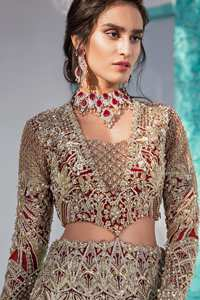 Heavy embellished bridal dress, with V Shaped blouse and skirt encrusted with swarovski stones, pearls, tilla and kora dabka along with a heavy embellished skin shawl. Beautifully paired up with deep red dupatta with sprinkled sequins and heavily embroidered borders. Best combo for a bridal.