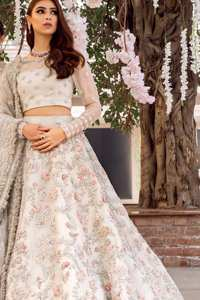 This super stunning skirt is made of rich floral embroidery which is further enhanced with kora dabka work. Blouse is meticulously embellished from neckline and sprinkled floral motifs on ground. It is paired up with ivory dupatta embellishment on sides which looks so breathtaking elaborate it with crisscross lines.