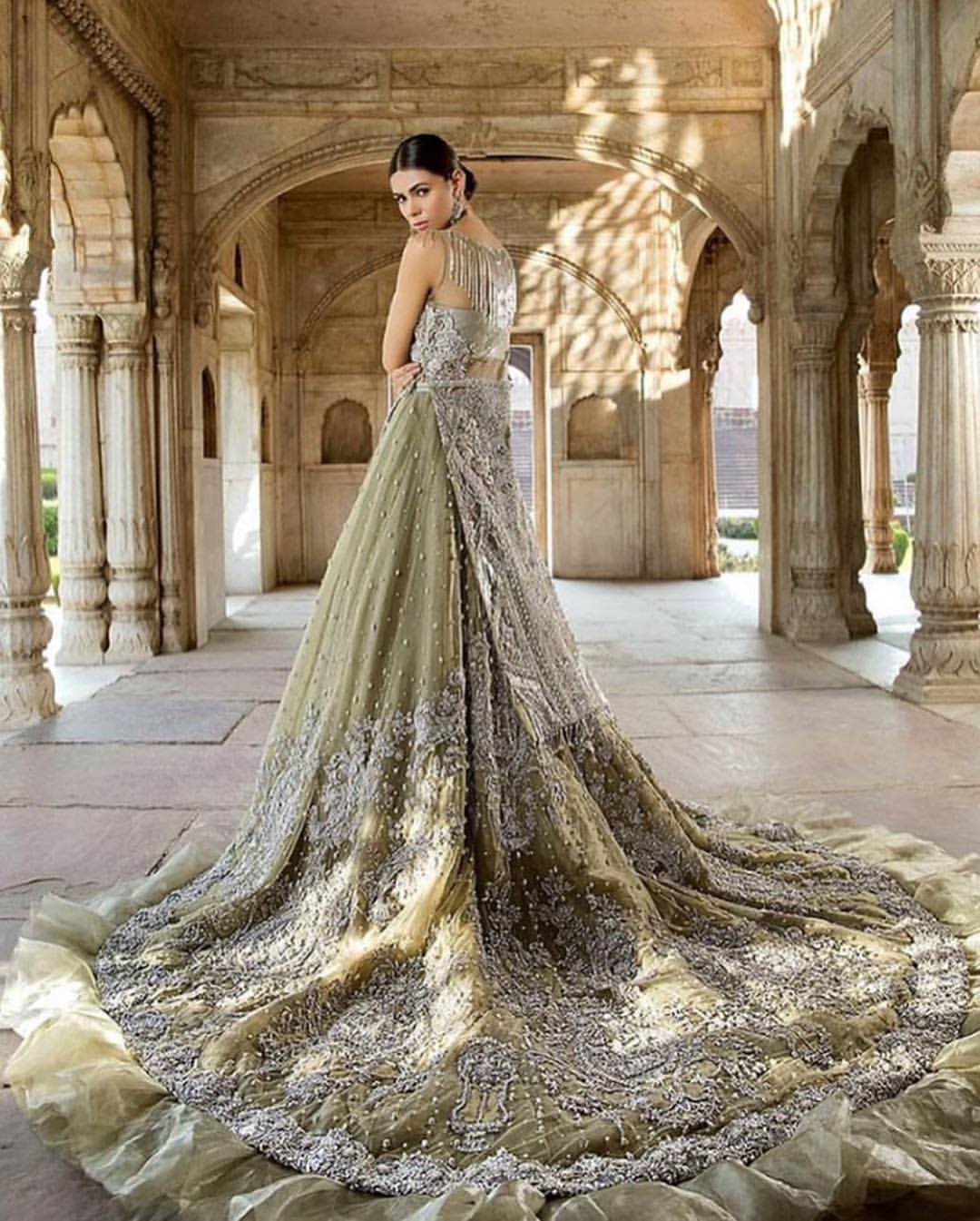 Redefine your style in this traditional and versatile ensemble ornamented with floral pattern embroidery furnished with silver shaded kora, dabka, tilla, sequins, kundan and pearls. It comes with heavily embellished lehengha, adorned with frill which adds to the look. It is stunningly coordinated with taupe gray dupatta with embellished borders on all sides and sequins spray all over it.