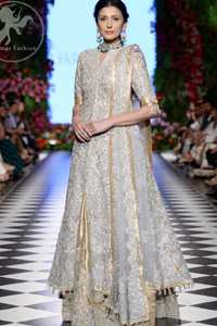 This dress is adorned with floral embroidery, highlighted with kora, dabka, tilla, sequins and pearls. It is allured with intricate embroidered motifs and delicate tassels. It is decorated with brocade applique. It comes with embellished lehengha. It is artistically coordinated with chiffon dupatta which is allured with four sided border.