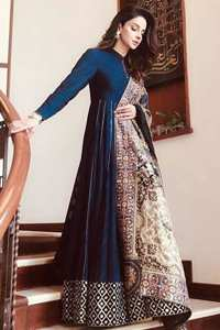 Look alluring in this floor length frock embellished with kora, dabka, tilla, sequins and pearls. The border on the daman is enhanced with embellished floral pattern, detailing that instantly draws attention. It comes with matching cigarette pants. Multiple panels adds to the look. It is paired up with embroidered shawl with sequins sprinkled and finished with light embroidered edges.