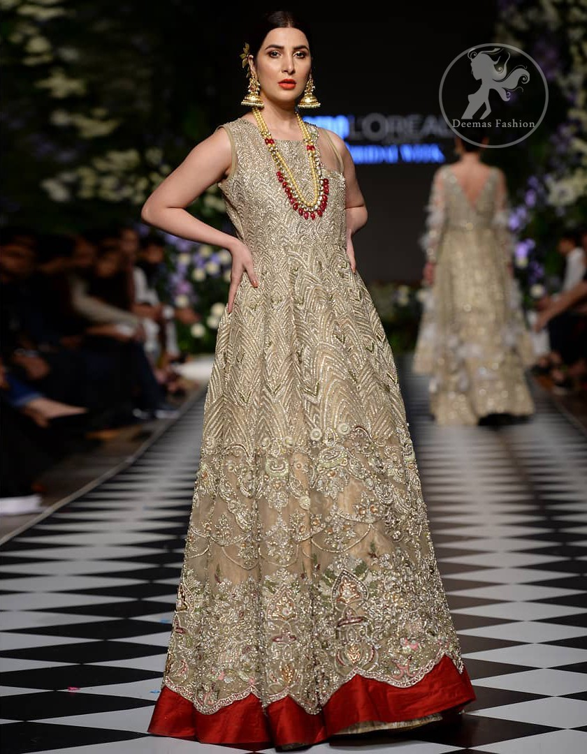 Delicately crafted and personifying chic elegance with an element of grandiose. This dress is beautifully sculptured with floral embroidery, adorned with cutwork borders embellished with dull gold and silver kora, dabka, pearl and sequins work all over. Moreover it is enhanced with different styles multiple colored embroidered motifs and finished with marron applique. This outfit comes with brocade pajama. It is coordinated with tissue dupatta which is sprinkled with sequins all over it.