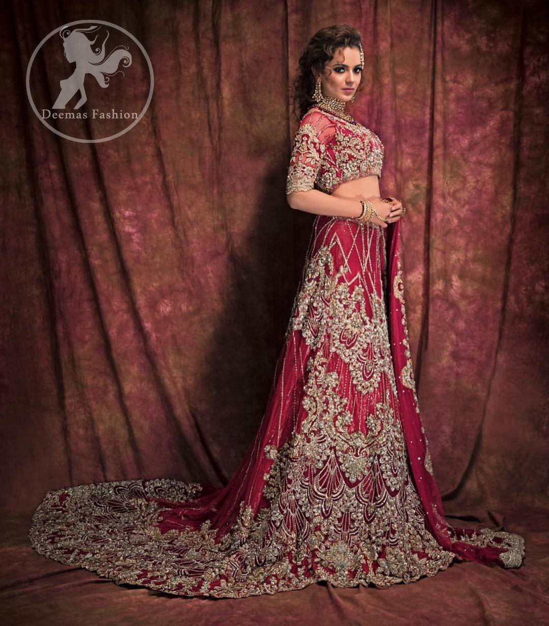 Exude glamour in this trendy lehnga with light golden and silver embroidery instantly draws attention. The blouse is enhanced with golden and silver kora, dabka, tilla, swarovski crystals and zardozi embroidery and a beautiful embellished motifs on the sleeves. Complete the look with artfully coordinated lehenga which is ornamented with a bold and captivating back trail design with a traditional intricate embroidered. The dupatta incorporates beautifully designed borders on all four sides and scattered sequins on the ground that gives the right amount of glamour to the outfit.