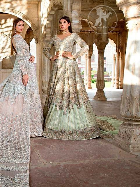 Reflecting exuberant color play in this ethereal piece meticulously highlighted with swarovski, pearl, silver kora and dabka. Heavily embellished in the front with intricate embroidered pattern and rich hemline. The sleeves are embellished with floral embroidery all over it. It comes with brocade pajama. This dress is paired with heavily embroidered organza dupatta that gives the right amount of glamour to the outfit. It is further furnished with four sided embellished border and geometric patterns.