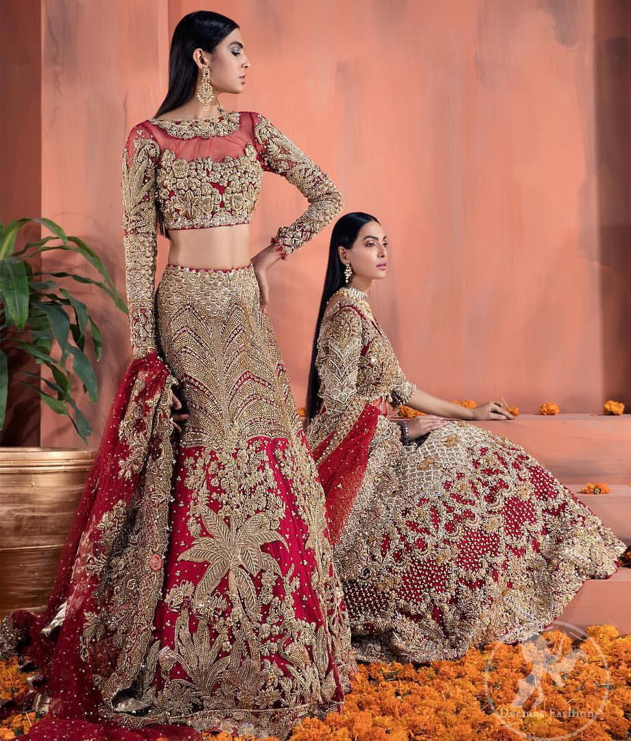 Reflecting royalty and the majestic beauty of statuesque shape and silhouette this bridal dress is perfect for your special day. This traditional outfit is aesthetically designed with motifs and floral patterns, embellished with kora, dabka, nakshi, sequins, crystals and stones. The back of the maxi also adorned with floral motifs in kora, dabka with sequin spray all over. It comes with brocade pajama. It is paired with heavily embroidered organza dupatta that gives the right amount of glamour to the outfit.