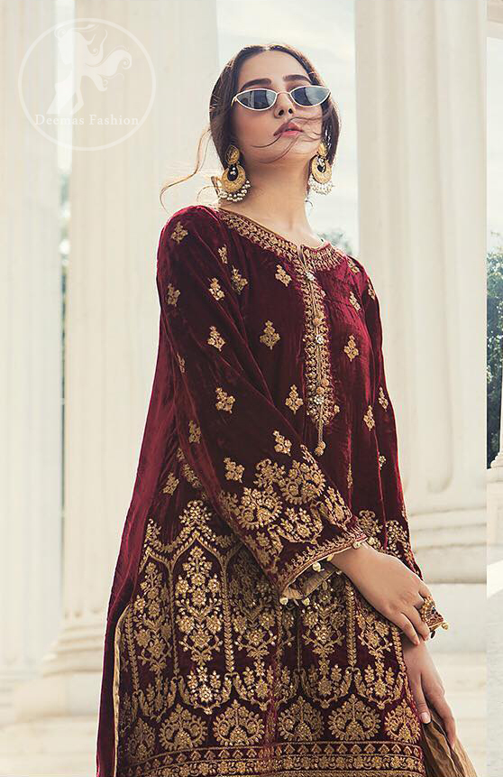 This dress is beautifully decorated with floral embrroidey. Decorated with mesmerizing antique gold kora, dabka and zardozi embellished neckline border and sleeves. Our maroon velvet shirt will add glamour to your style. Delicate tassels adds to the bling. It comes with jamawar shalwar. Dupatta is of tissue fabric.