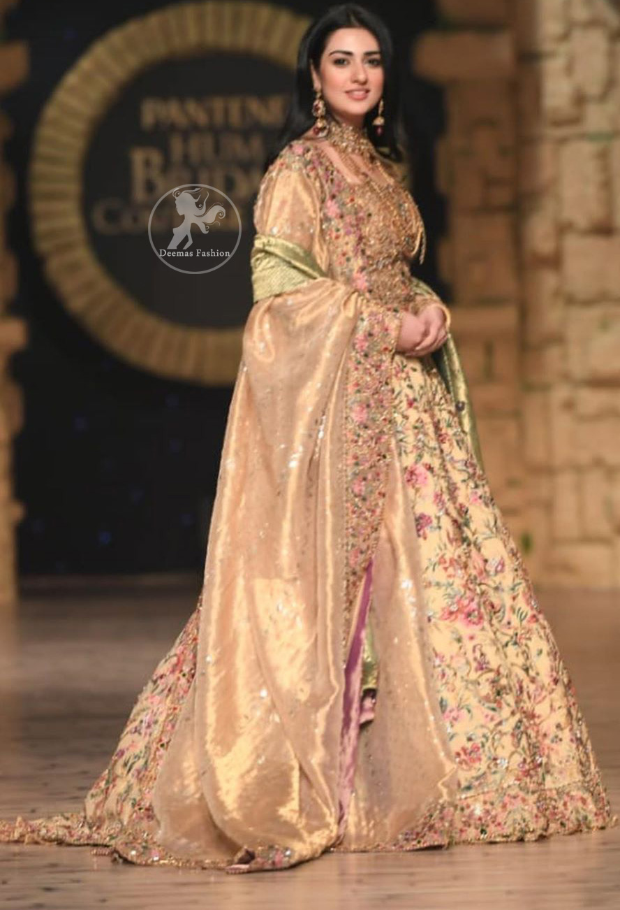 Modern yet traditional: This regal muddy waters maxi is an immensely captivating traditional piece, enhancing the art of classical heritage showcasing the craftsmanship of antique shaded kora, dabka & mukesh detailed with pearls; artistically embellished to give a beautiful rhythm to the outfit. Furthermore it is enhanced with multiple colored thread embroidery. It comes with brocade pajama. This outfit is paired with an ethereal bridal dupatta focusing on kora and dabka handwork borders on all four sides.