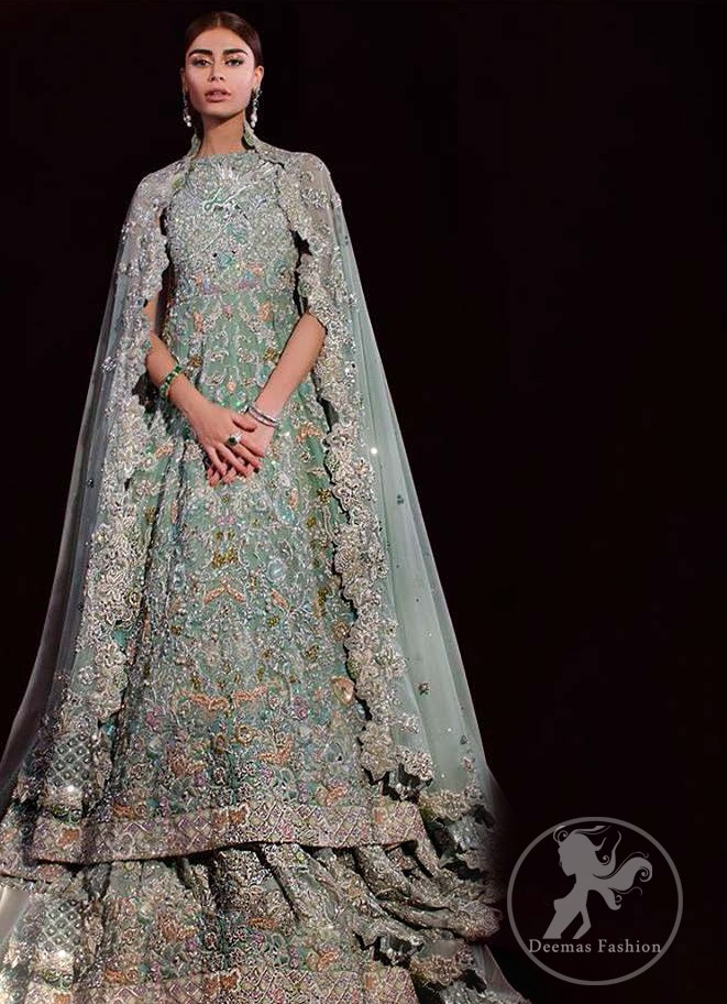 Reflecting exuberant color play in this ethereal piece meticulously highlighted with zardosi work. Heavily embellished in the front with intricate embroidered pattern done with silver and golden kora, dabka, kundan, tilla and sequins. It comes with fully embellished lehenga. Frock and lehenga both are decorated with applique on the bottom. The outfit is coordinated with net dupatta which is sprinkled with sprinkled sequins. It is further furnished with four sided scalloped border.