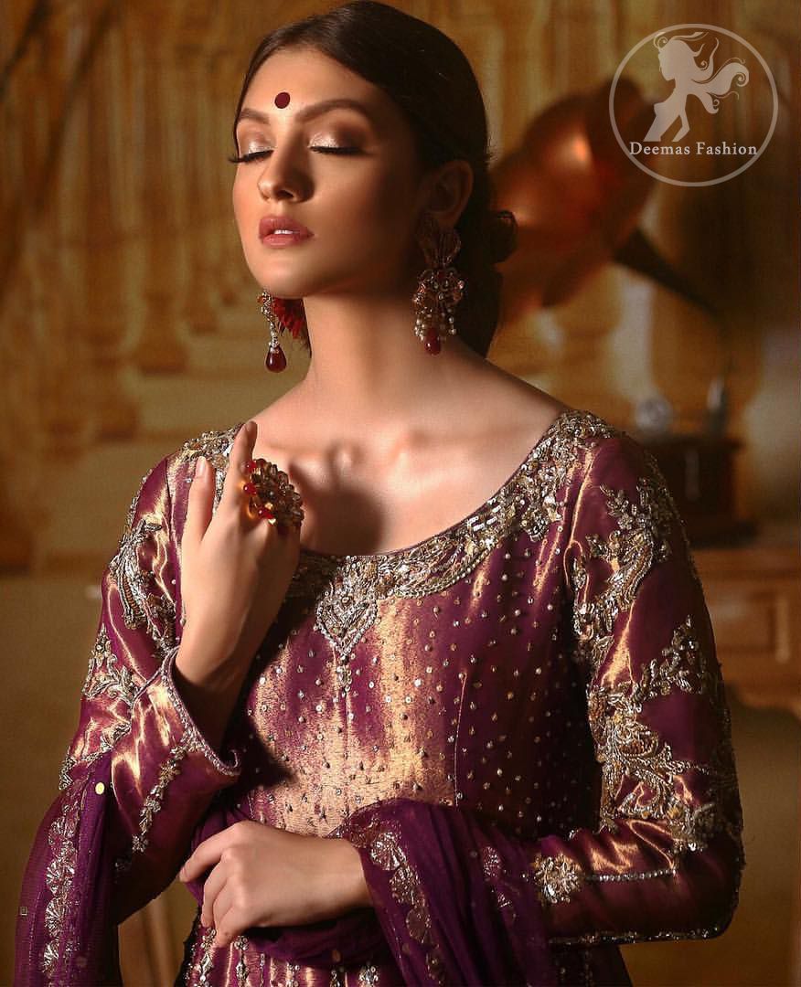 Delicately crafted and personifying chic elegance with an element of grandiose. The detailed kundan work on neckline and vertical panel stripes ornamented with silver and antique shaded kora and dabka embroidery on the neckline, the thick scalloped borders and floral bunches refined the classical look. It comes with beautifull brocade churidar oajama. It is coordinated with organza dupatta which is decorated with gota work on the ground and zardosi work on all four sides of borders.