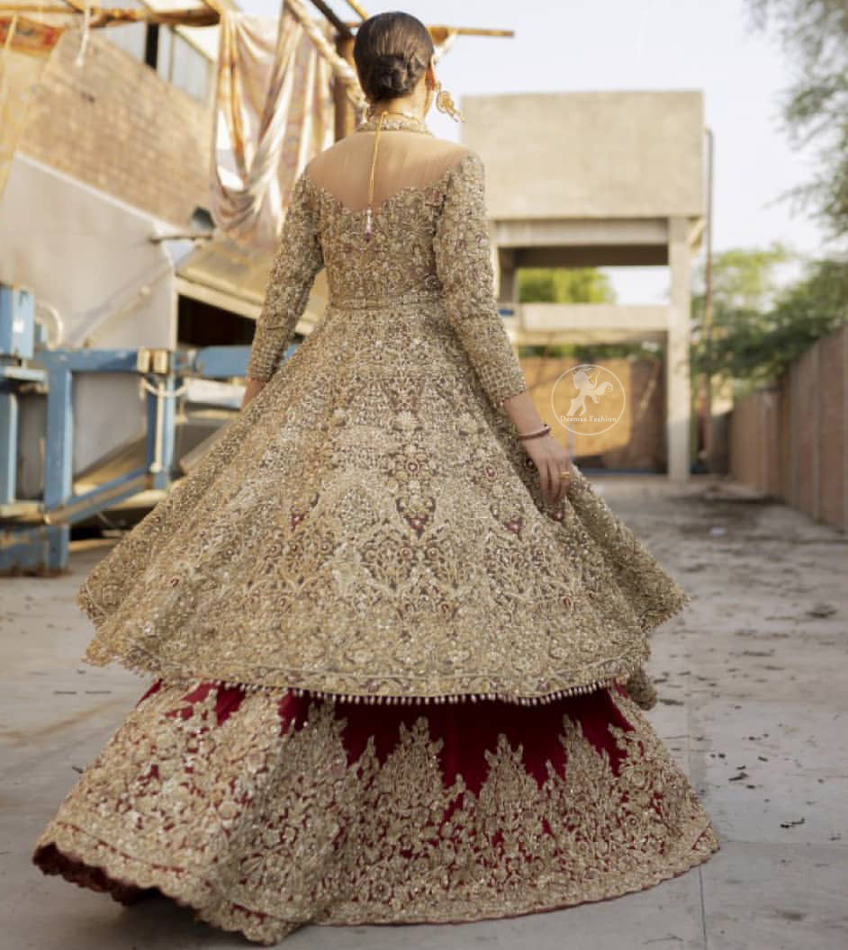 This bridal dress is perfect for your special day. Create a vision of elegance with red wine lehenga decorated with intricate gota detailing and silver gold kora dabka and sequins. Heavy embroidered frock comprises with red wine scalloped border lehenga. The outfit is coordinated with an organza dupatta with hand embroidered borders on all four sides and gota sequin work on the ground.