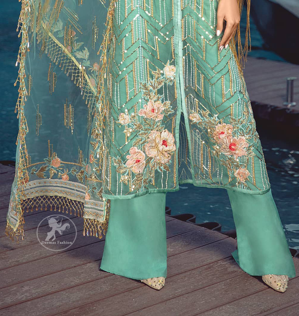 A must have creation for day to evening wear. Reflecting exuberant color play in this ethereal piece meticulously highlighted with swarovski, pearl, silver kora and dabka. It is also decorated with multiple color thread embroidery and golden tassels. It comes with full embroidered bell sleeves. This outfit is coordinated with raw silk bell bottom. The outfit comprises with tissue dupatta which is sprinkled with sequins on the ground.