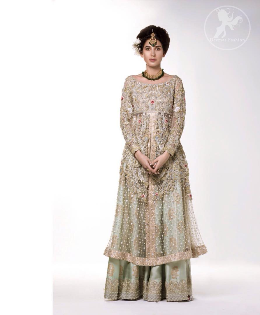 The perfect combination of tradition and class. Dazzle in this made to perfection, richly embroidered front open net outfit decorated with intricate zardozi embroidered front highlighted with kora, dabka, tilla, sequins and pearls embroidered borders on daaman and sleeves. Furthermore the shirt is fully decorated with sprinkled pearls all over it. This outfit is comprises with light olive green sharara highlighted with zardozi details at the bottom. Complete the look with tea rose dupatta sprinkled with sequins all over.
