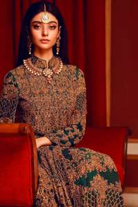 This dress is majestic beauty. Delicately crafted and personifying chic elegance with an element of grandiose. A full heavily embroidered maxi with zerdozi work details all over. Having full length sleeves adorned with motifs and geometric patterns. The bottom of the maxi is enhanced with rich floral embroidery. It comprises with churidar pajama.