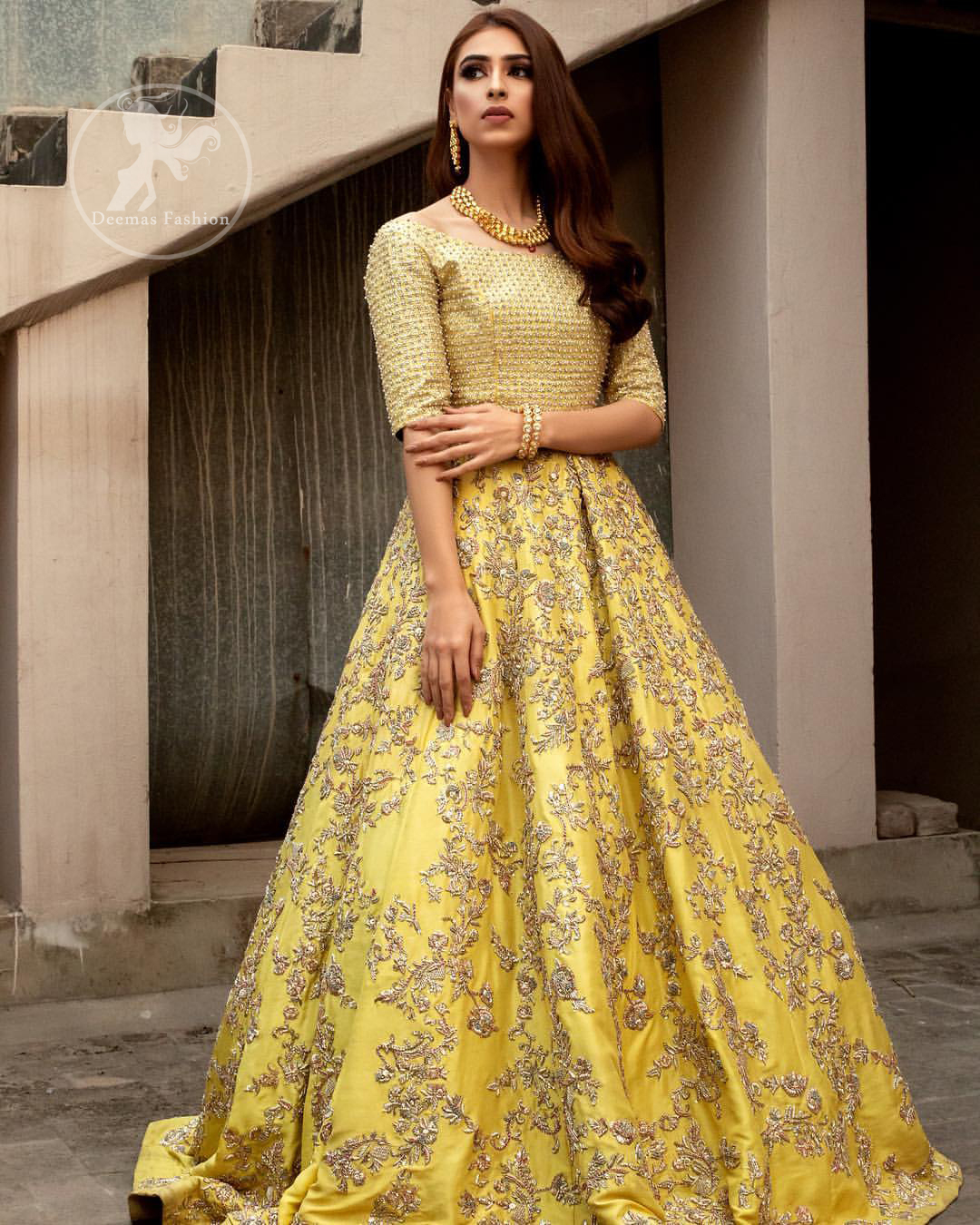 Tradition meets modernity. Exhibit elegance in this yellow blouse lehengha enhanced with kora and dabka embroidery adorned with Swarovski crystals and zardozi is perfect ensemble for mehendi. The outfit is coordinated with tissue dupatta with hand embroidered borders on all four sides and zardozi sequins work on the ground. It comes with raw silk fully embroidered lehengha.
