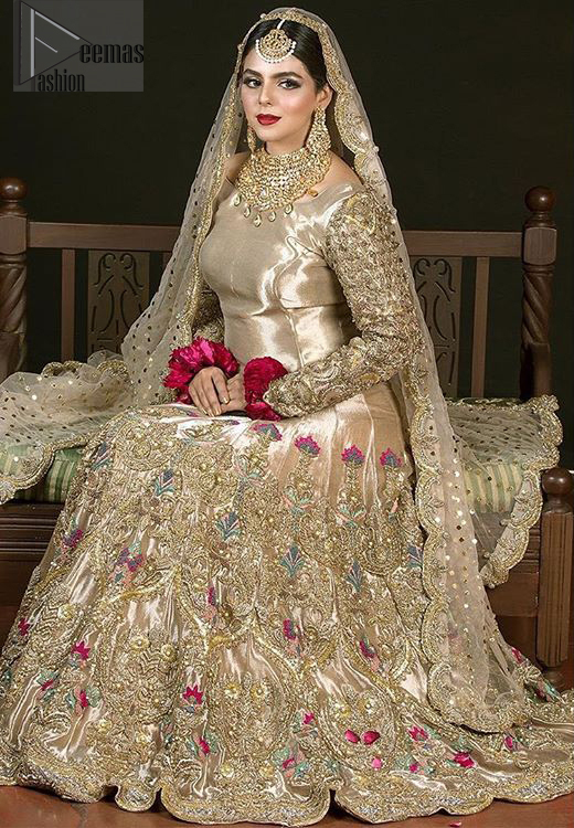 The antique brass lehenga is an example of remarkable handiwork. With a lot of attention to detail, the intricate sequencing, kora, dabka embellishment and multiple color thread embroidery makes this outfit look like nothing but a dream. The floor kissing asymmetrical lehenga add to its charm. Elegance is personified when it gets paired up with beautiful embroidered dupatta with sequins spray all over and embellished scalloped border datailing.