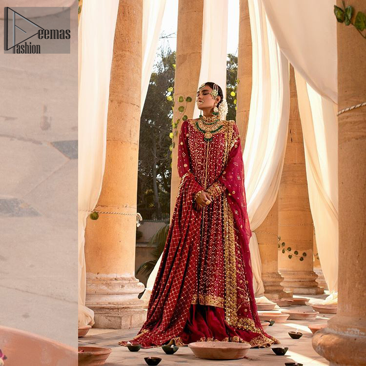 A must have creation for your wedding day. This traditional front open style bridal is aesthetically designed with sequins beads details, embellished with kora, dabka, nakshi and sequins. The daaman is emphasized with intricate zardosi details that gives perfect ending to this pishwas. Style it up with artfully coordinated maroon sharara finessed with golden zardosi details at the bottom. The dupatta incorporates beautifully designed borders on all four sides, focusing on the criss cross pattern to give it a perfect look.