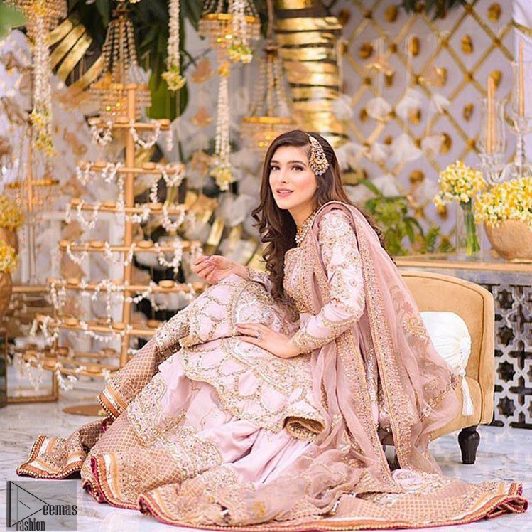 Brighten up your look with this outfit on your reception or nikah day. Wear this soft and supple hues richly decorated by shades of golden and silver with gota work motifs and geometric patterns at daaman. Having embellished bodice and full length sleeves adorned with geometric patterns and motifs. Style it up with artfully coordinated tea pink gharara finessed with floral motifs and gota work details at the bottom. Thin border on all four sides of the dupatta which have gold tila embroidery with sequins, beads and crystal touching.