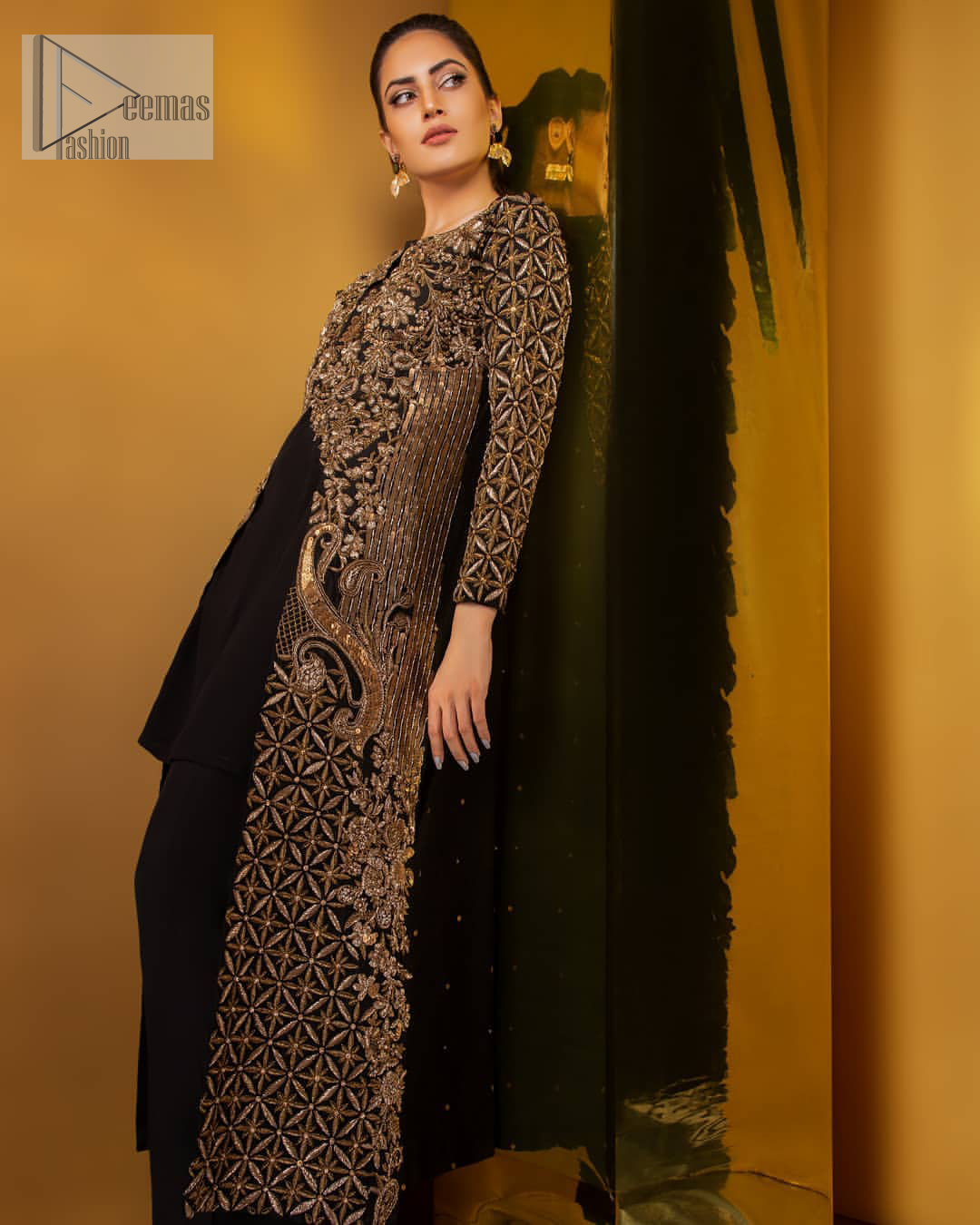 Perfected with antique gold and dark antique embellishments this black velvet ensemble is timeless masterpiece in to a chic fantasy. Delicately crafted with zardosi, kora, dabka, tilla, sequins and pearls. Furthermore it is adorned with geometric patterns all over.  Beautifully designed sleeves is an amalgamation of geometric and floral design elements. This outfit is finished with black raw silk palazzo pants and pure chiffon dupatta.