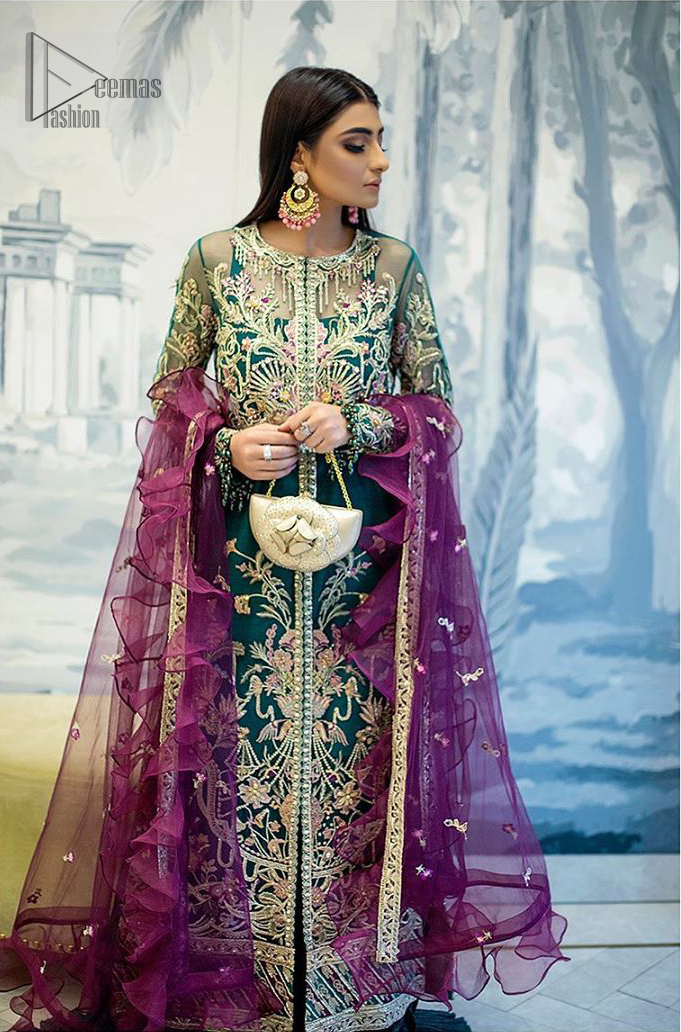 Modern yet traditional. Boost your confidence and style in this glamorous attire accentuated with finest thread work and zardosi embroidery. The outfit is beautifully sculptured with colorful embellishment and finessed with beautiful embellished applique hemline. Having full sleeves with scalloped finishing. The outfit is coordinated with crushed sharara and magenta dupatta adorned with four sided lace border and frill.