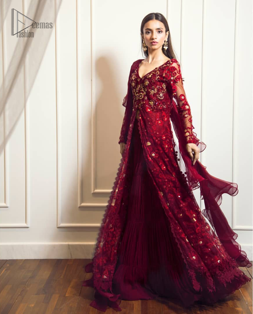 This exceptionally detailed front open gown lehenga is cut in a seductive fit and flare silhouette that's sure to turn heads on your big day. The bodice with plunging V-neckline is adorned in richly floral lace with fabulous sparkle. Furthermore the bodice is highlighted with golden zardozi work and floral applique. Center slits and bottom of the gown is beautifully decorated with floral lace. It is coordinated with maroon crushed lehenga and organza dupatta.