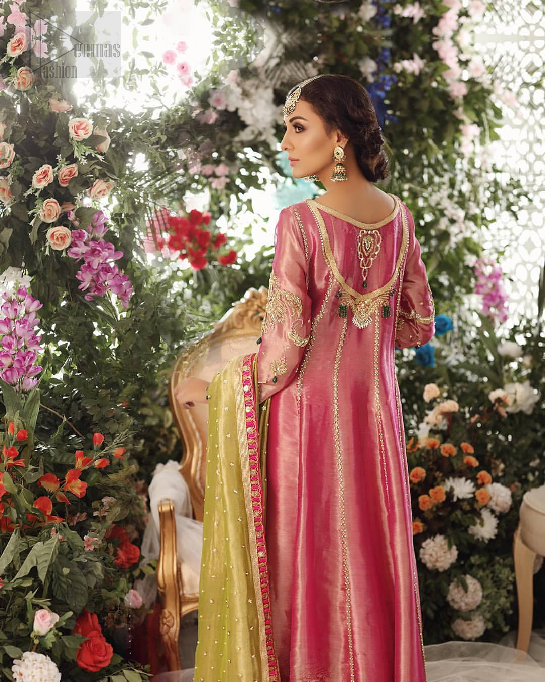 Nothing speaks of femininity and class louder than this mehndi outfits for bridesmaids. This beautiful mehndi dress comes with anarkali frock with beautiful embellished motifs around the scalloped hemline and vertically worked gold lines and heavily embellished neckline with light golden, champagne and antique shaded zardozi work. It comes with sharara adorned with colored floral embroidery with champagne embellishment. Complete the look with parrot green dupatta having four sided applique borders and sequins spray on the ground.