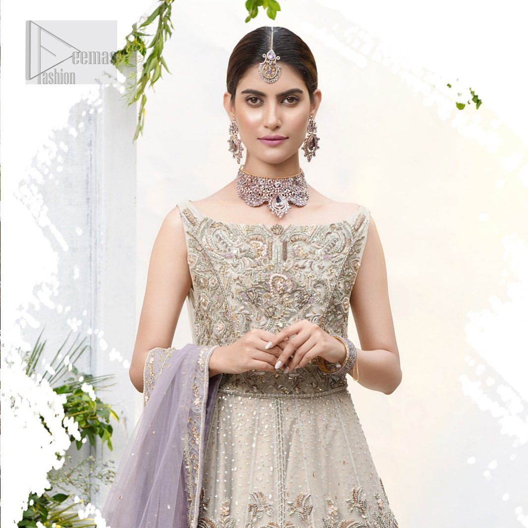 The ultimate in feminine elegance with fine detail to die for. Our bride makes a statement in this stunningly floraison, perfect blend of glamour and tradition with outstanding craftsmanship and gorgeous detailing. This front open pishwas is gorgeously decorated with floral bunches all over done with antique shaded zardozi work. It comprises with light beige jamawar lehenga with zardozi detail on the bottom. Style it up with light purple net dupatta sprinkled with sequins and four sided embellished border.
