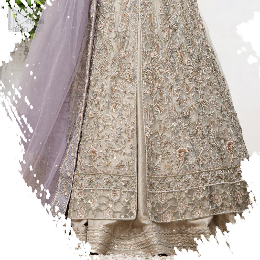 The ultimate in feminine elegance with fine detail to die for. Our bride makes a statement in this stunningly floraison, perfect blend of glamour and tradition with outstanding craftsmanship and gorgeous detailing. This front open pishwas is gorgeously decorated with floral bunches all over done with antique shaded zardozi work. It comprises with light beige jamawar lehenga with zardozi detail on the bottom. Style it up with light purple net dupatta sprinkled with sequins and four sided embellished border.The ultimate in feminine elegance with fine detail to die for. Our bride makes a statement in this stunningly floraison, perfect blend of glamour and tradition with outstanding craftsmanship and gorgeous detailing. This front open pishwas is gorgeously decorated with floral bunches all over done with antique shaded zardozi work. It comprises with light beige jamawar lehenga with zardozi detail on the bottom. Style it up with light purple net dupatta sprinkled with sequins and four sided embellished border.