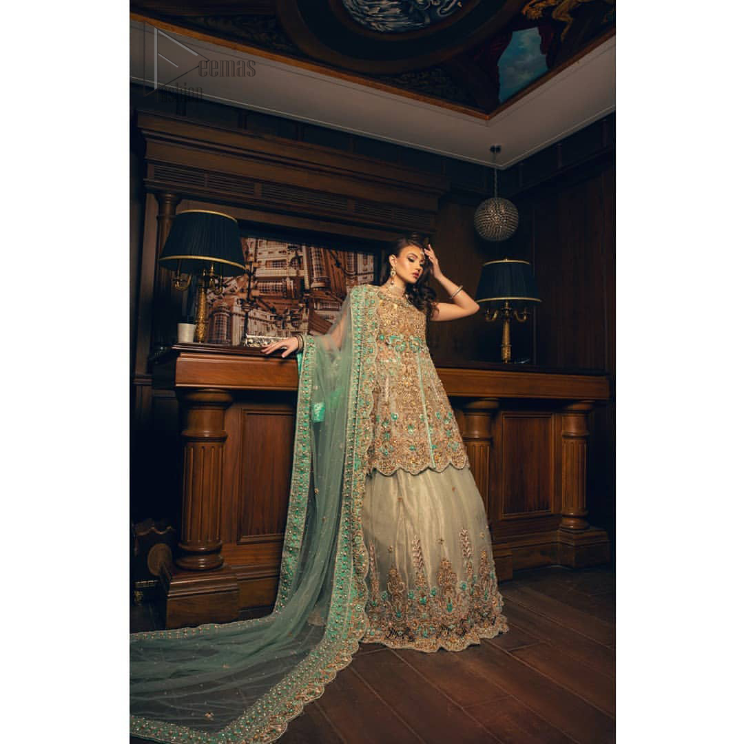 Classic, timeless and truly beautiful. Upholding the idea of simple is beautiful, you would definitely want to wear this outfit for your next occasion. The front open short frock is adorned with delicate arrangement of hand embellished floral patterns with multiple color thread embroidery and antique shaded zardozi work. The scalloped hemline done with champagne embellishment gives the right amount of glamour to the outfit. It coordinates with light fawn lehenga with scalloped bottom and heavy embellishment on it with zardozi. The look is completed with mint green organza dupatta with detailed work on the borders.