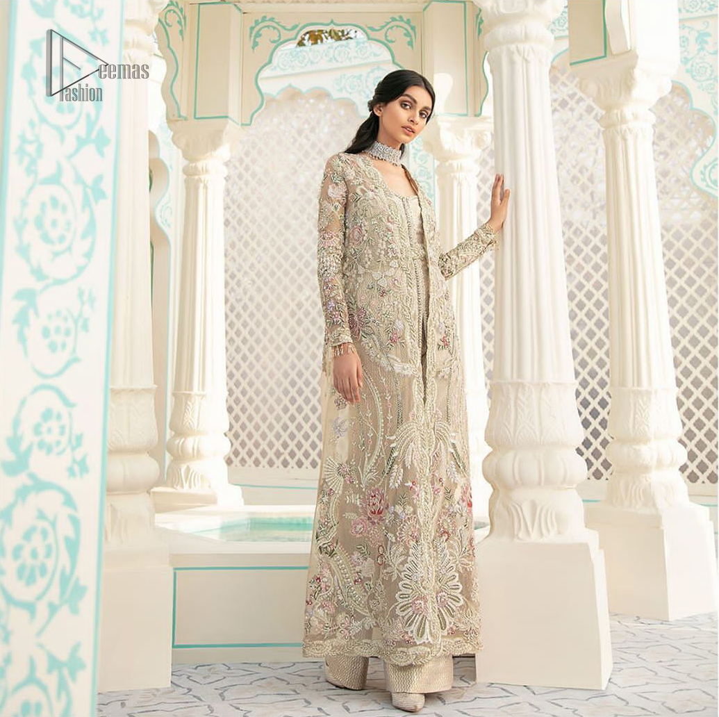 An example of beauty and elegance. A perfect ensemble for this festive season with divine detailing of thread embroidery, color balance and well-crafted scalloped bottom. The front open gown is sculptured with light golden zardozi work all over and multiple color thread embroidered floral. Complete the look with inner jumpsuit style it up with a fixed waist belt. Paired it up with organza dupatta adorned with scattered floral motifs.