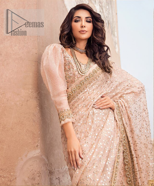 Steal the show with this endearing chiffon saree with intricate yet rich mukesh details. Crafted artfully with detailed thread embroidery on saree pallu and traditional neckline finessed with kora, dabka and kundan. Having full sleeves with mukesh details and zardosi finishing. Furthermore it is adorned from all sides with antique shaded kora, dabka, tilla and sequins.