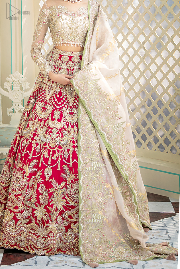 This outfit is enhanced with hand embellishments on bodice and sleeves finishing with dangling tassels on the blouse. The lehenga is an amalgamation of a variety of our signature motifs, fine materials, and traditional yet contemporary silhouettes.