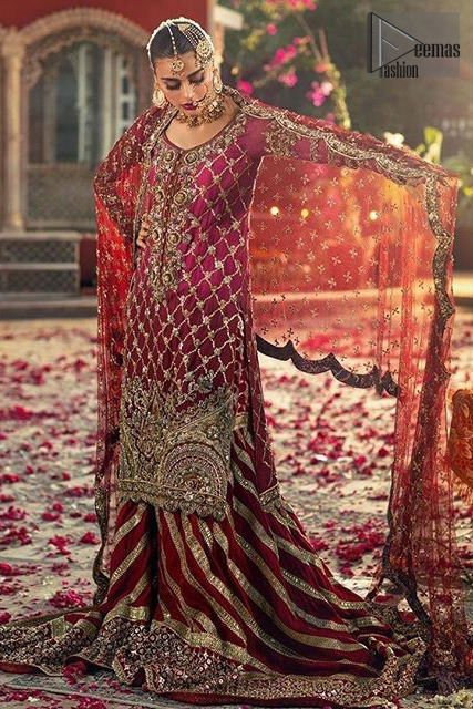 This elegant ensemble turns timeless piece into a chic fantasy. Crafted artfully with detailed work on border and traditional neckline finessed with kora, dabka and kundan. Shirt is furthermore enhanced with geometric patterns and scalloped lace hemline. It comprises with red sharara with embellished detailed bottom and gotta work. Style it up with red chiffon dupatta focusing on kora and dabka handwork scalloped borders on all four sides and sprinkled sequins on all over.