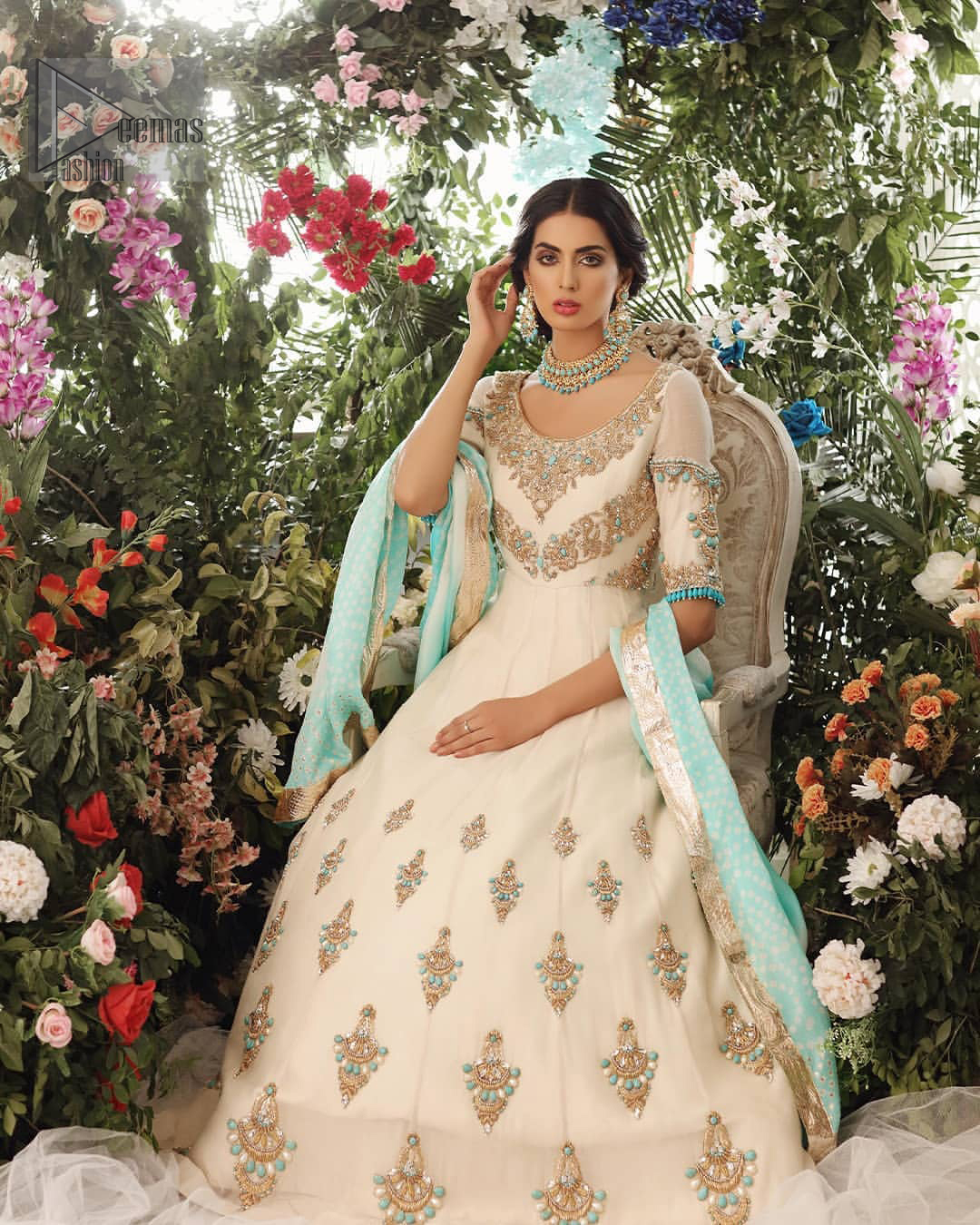 This outfit should be the next addition to your wardrobe. An example of beauty and elegance. Look breathtakingly stylish in this embroidered regalia furnished with intricate embroidered neckline which is embellished with antique shaded zardozi work and ferozi stones. Furthermore, this multiple panel frock is adorned with different sized motifs scattered all over the frock. It is coordinated with ivory churidar pajama. Finished the look with self printed chiffon dupatta having four sided applique on it.