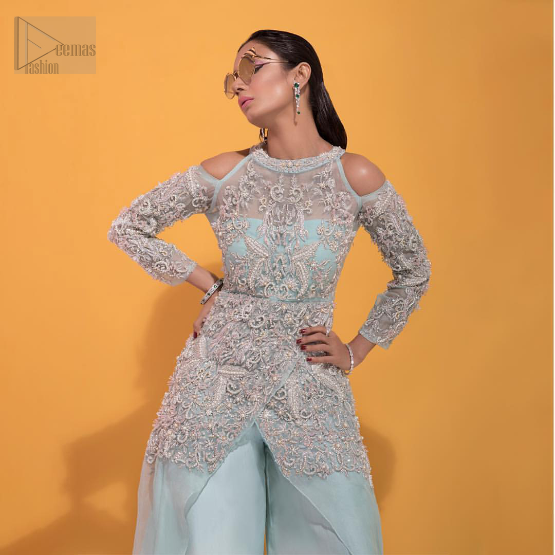 A fashion forward style statement that is contemporary yet chic. This handcrafted remarkable ensemble includes art deco design elements. Unique craftsmanship and detailed embellishments on the pastel green shirt creating delicate yet flamboyant pieces of art in your wardrobe collection. Cold Shoulder sleeves and halter illusion neckline make it more remarkable. To complete the look, go with palazzo pants and organza dupatta sprinkled with sequins all over.