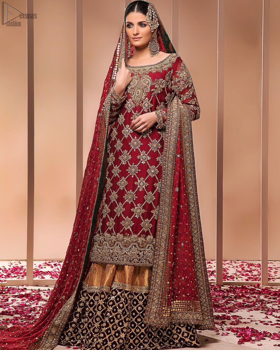 This style-savvy bride totally pulled off our classic bridal wear with an unmatchable grace and giving major bridal goals. The lehenga colour is the perfect feminine and delicate shade with its meticulously crafted fabrication with geometrically embellished border filled with gorgeous tiny floral motifs in it. The shirt is beautifully ornamented with geometrically arranged motifs and intricate details at the bottom. The zardozi embroidery is done in the shade of tan. Pair it up with maroon organza dupatta adorned with sterling sequences and four-sided embellished borders to give it a regal look.
