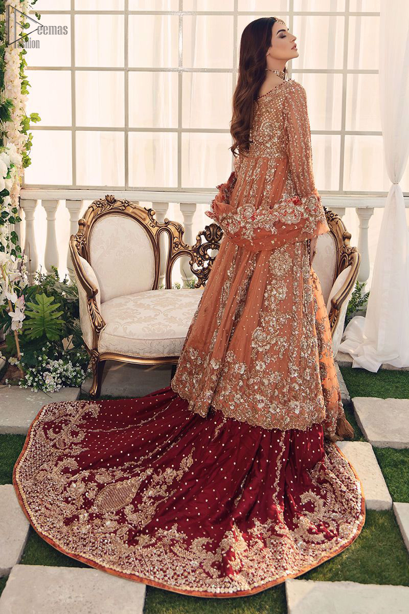Pakistani Bridal Wear Salmon Front Open Gown - Maroon Back Train Lehenga - This fairytale ensemble is everything that you need to impress everyone. The maroon Lehenga is an example of remarkable handwork. With a lot of attention to detail, the intricate sequencing using sequins, kora, dabka, crystals beading, and threads makes the lehenga look like nothing but a dream.